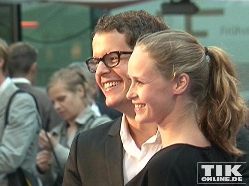 Inez Bjoerg und David Mirko Lang freundlich lächelnd auf