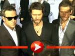 Robbie Williams und Take That umjubelt auf dem roten Teppich