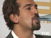Elyas M'Barek nimmt einen Schluck Wasser auf der Medienboard Party 2014