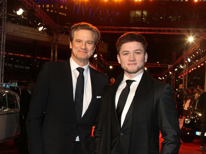 Colin Firth strahlt mit Taron Egerton um die Wette