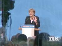 Kanzlerin Angela Merkel an ihrem 60. Geburtstag hinter dem Rednerpult